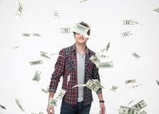 Smiling man throwing money into air Stock Photo