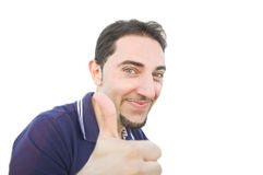 Smiling man with thumb up on a white background. Royalty Free Stock Photography