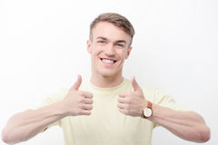 Smiling man thumbing up on isolated background Royalty Free Stock Photos