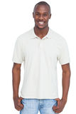 Smiling man with thumbs in pocket Royalty Free Stock Photography