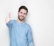 Smiling man with thumbs up sign Royalty Free Stock Photo