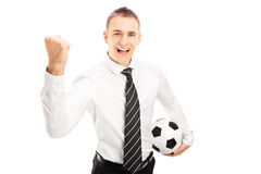Smiling man with tie holding a soccer ball Royalty Free Stock Photos
