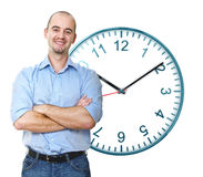 Smiling man and time Stock Images