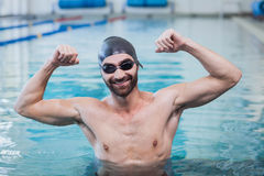 Smiling man triumphing with raised arms. At the pool Royalty Free Stock Images