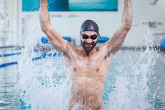 Smiling man triumphing with raised arms. At the pool Stock Photos