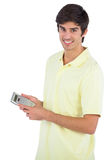 Smiling man using calculator Stock Photos