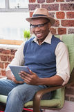 Smiling man using digital tablet Stock Photo