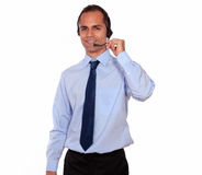 Smiling man using headphone with microphone Royalty Free Stock Photo