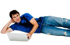 Smiling man using a laptop Royalty Free Stock Photo