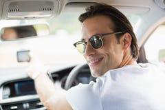 Smiling man using satellite navigation system Stock Photo