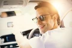 Smiling man using satellite navigation system. In his car stock photos