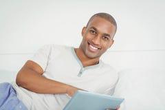 Smiling man using tablet Royalty Free Stock Image