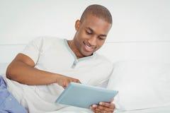 Smiling man using tablet Stock Image
