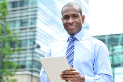 Smiling man using tablet pc at outdoors Stock Photos