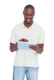 Smiling man using tablet pc Royalty Free Stock Image