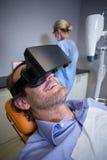 Smiling man using virtual reality Stock Image