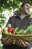 Smiling Man With Vegetable Basket Stock Image