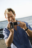 Smiling Man With Video Camera Stock Photo
