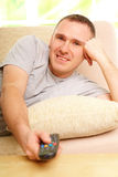 Smiling man watching television Stock Photo
