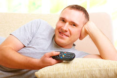 Smiling man watching television Royalty Free Stock Images