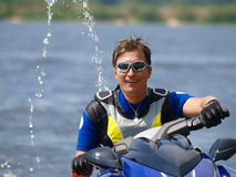 Smiling man on Wave Runner. On summer river in daylight Stock Photography