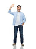 Smiling man waving hand Royalty Free Stock Photo