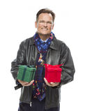 Smiling Man Wearing Black Leather Jacket Holding Christmas Gifts on Whit Royalty Free Stock Images