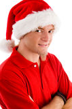 Smiling man wearing christmas hat. On an isolated background Stock Images