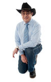 Smiling man wearing cowboy hat Stock Photo