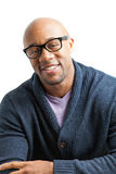 Smiling Man Wearing Glasses. Stylish African American man wearing black framed glasses. Shallow depth of field Royalty Free Stock Photos