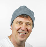 Smiling man wearing a grey cap isolated on a white background Royalty Free Stock Photo