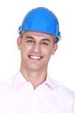 Smiling man wearing a hardhat royalty free stock image