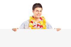 Smiling man wearing hawaian costume on a panel Stock Photo