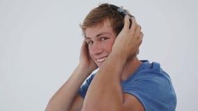 Smiling man wearing headphones Stock Photos