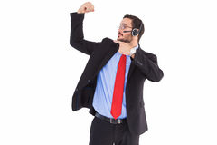Smiling man wearing a headset while pointing his bicep Stock Photo