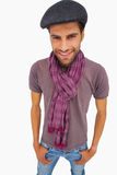 Smiling man wearing peaked cap and scarf Stock Photo