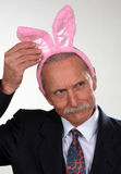 Smiling man wearing rabbit ears Stock Photos