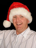 Smiling man wearing Santa hat Stock Photography