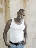 Smiling man wearing a white tank top Stock Images