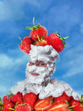 Smiling man with whipped cream and strawberries Royalty Free Stock Images