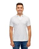 Smiling man in white blank polo t-shirt Royalty Free Stock Image