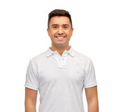 Smiling man in white blank polo t-shirt Stock Photo
