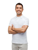 Smiling man in white t-shirt with crossed arms Stock Image