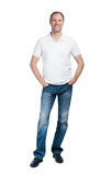 Smiling man in white t-shirt and jeanse isolated on white backgr Stock Photos