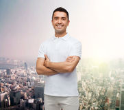 Smiling man in white t-shirt over city background Stock Photography