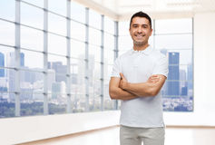 Smiling man in white t-shirt over office or home Royalty Free Stock Photo