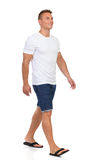Smiling Man In White T-shirt Walking. Front Side View Stock Images