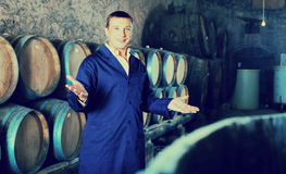 Smiling man wine technician working in storage Stock Photos