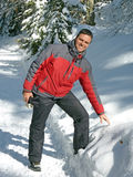 Smiling man in winter landscape Royalty Free Stock Images
