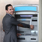 Smiling man withdrawing money at ATM Stock Photography